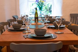 The Old Farmhouse Dining Table Set for Dinner